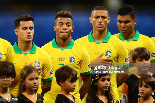 Brazil line up for the national anthem ahead of the Copa America Brazil 2019 group A match between Brazil and Venezuela at Arena Fonte Nova on June...