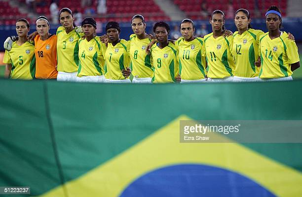 Brazil line up for the singing of the national anthems before the start of the women's football gold medal match on August 26 2004 during the Athens...