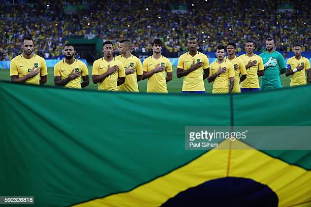 Brazil line up for their national anthem before the Men's Football Final between Brazil and Germany at the Maracana Stadium on Day 15 of the Rio 2016...