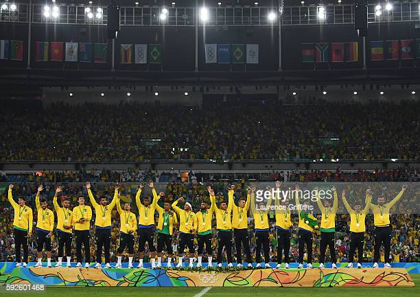 Brazil line up to receive their gold medals after winning the Men's Football Final between Brazil and Germany at the Maracana Stadium on Day 15 of...