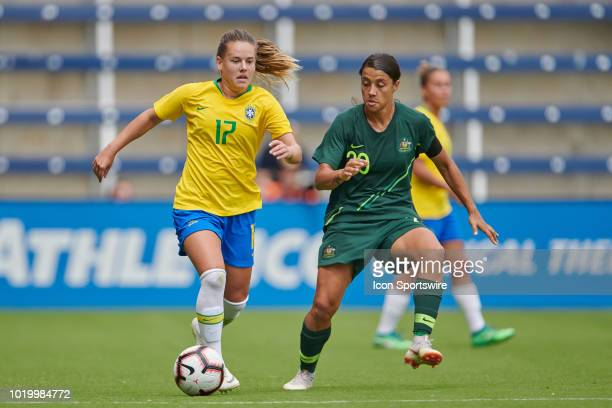 Brazil midfielder Andressinha battles with Australia forward Sam Kerr for the ball in game action during a Tournament of Nations match between Brazil...