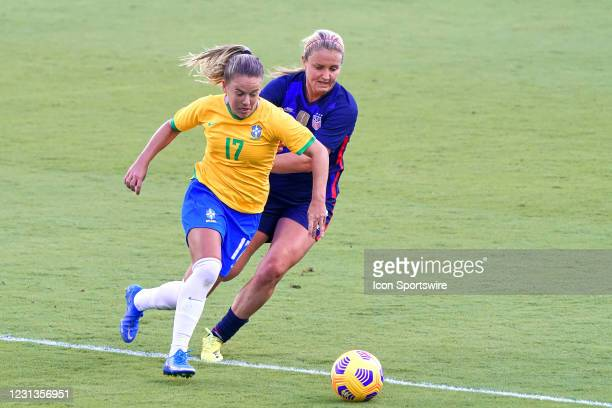 Brazil midfielder Andressinha battles with United States midfielder Lindsey Horan in action during a SheBelieves Cup game between Brazil and the...