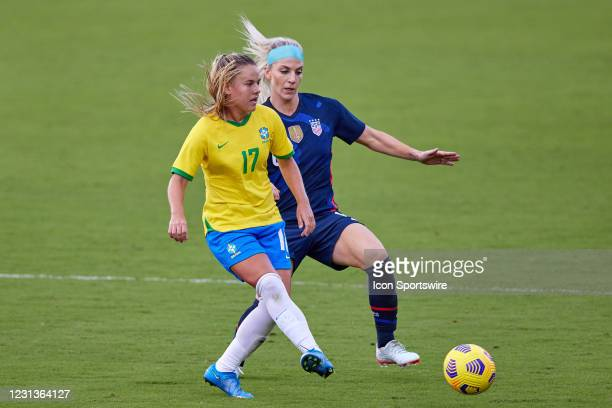 Brazil midfielder Andressinha battles with United States midfielder Julie Ertz in action during a SheBelieves Cup game between Brazil and the United...