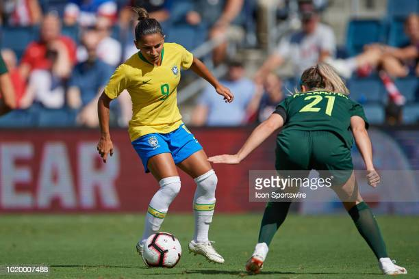 Brazil midfielder Debinaha battles with Australia defender Ellie Carpenter for the ball in game action during a Tournament of Nations match between...