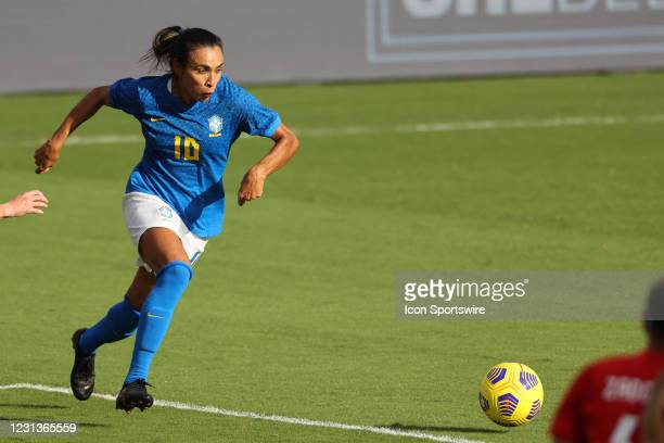 Brazil midfielder Marta dribbles the ball in action during a SheBelieves Cup game between Brazil and Canada on February 24, 2021 at Exploria Stadium...