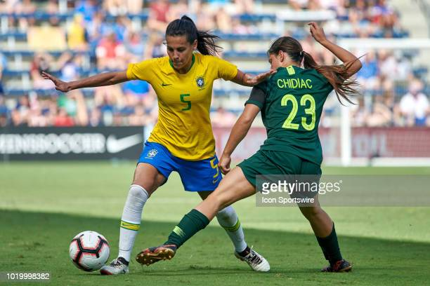 Brazil midfielder Thaisa battles with Australia midfielder Alex Chidiac for the ball in game action during a Tournament of Nations match between...