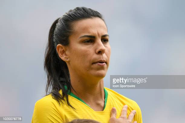 Brazil midfielder Thaisa looks on during the national anthem prior to the start of game action during a Tournament of Nations match between Brazil vs...