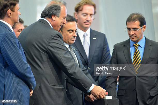 REZENDE Brazil Nissan Motor Co President Carlos Ghosn pushes the button at a ceremony unveiling the Japanese automaker's new plant in Rezende in the...