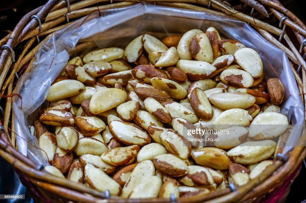 Brazil nuts for sale on a basket : Stock Photo