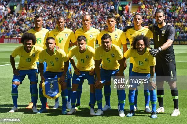 Brazil players Brazil's midfielder Paulinho Brazil's midfielder Fernandinho Brazil's defender Miranda Brazil's defender Thiago Silva Brazil's...