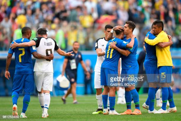 TOPSHOT Brazil players celebrate at the end of the Russia 2018 World Cup Group E football match between Brazil and Costa Rica at the Saint Petersburg...