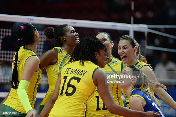 Brazil players celebrate during the FIVB Women's World Championship pool H match between Brazil and China on October 8 2014 in Milan Italy