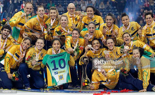 Brazil players celebrate with the trophy after beating Serbia in their World Women's Handball Championship 2013 Final match at Kombank Arena Hall on...