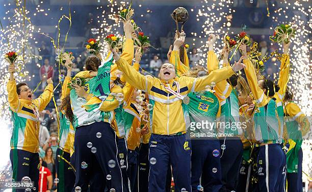 Brazil players celebrate with the trophy after beating Serbia in the World Women's Handball Championship 2013 Final match at Kombank Arena Hall on...