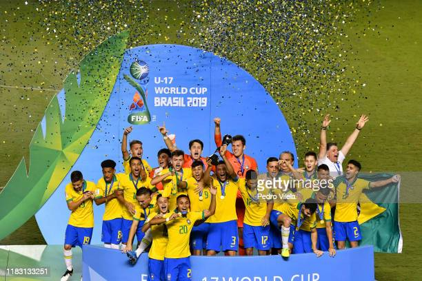 Brazil players celebrate with the World Cup Trophy after winning the final of the FIFA U17 Men's World Cup Brazil 2019 against Mexico at Bezerrao...