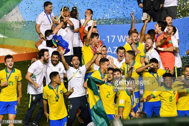 Brazil players celebrate with the World Cup Trophy after winning the final of the FIFA U-17 Men's World Cup Brazil 2019 against Mexico at Bezerrao...
