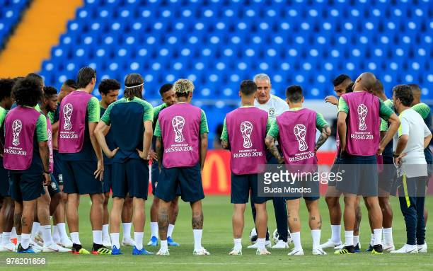 Brazil players gather round as Tite Head coach of Brazil gives his team instructions during a Brazil training session ahead of the FIFA World Cup...