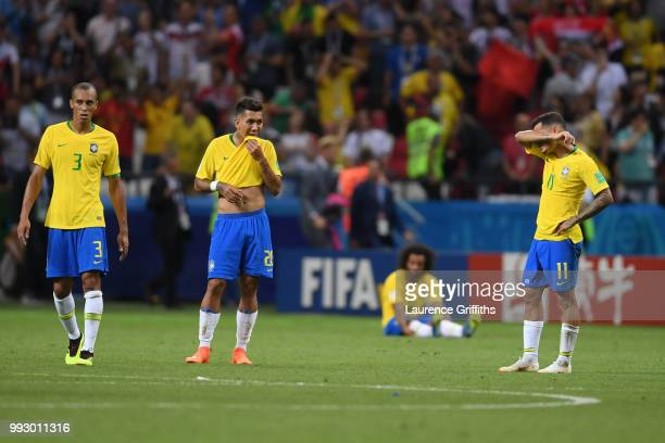 Brazil players look dejected following the 2018 FIFA World Cup Russia Quarter Final match between Brazil and Belgium at Kazan Arena on July 6 2018 in...