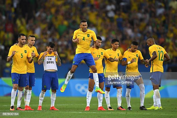 Brazil players react in the penalty shoot out during the Men's Football Final between Brazil and Germany at the Maracana Stadium on Day 15 of the Rio...