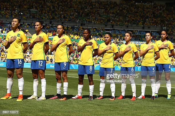 Brazil players sing the national anthem ahead of the Women's Football Semi Final between Brazil and Sweden on Day 11 of the Rio 2016 Olympic Games at...