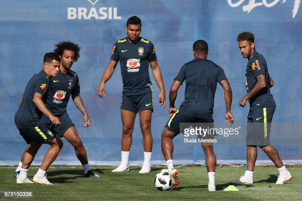 Brazil players take part in a drill during a Brazil training session ahead of the FIFA World Cup 2018 at YugSport Stadium on June 13 2018 in Sochi...