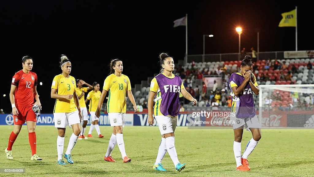 Brazil players walk off the pitch, after their loss to Japan during the FIFA U-20 Women's World Cup Papua New Guinea 2016 Quarter Final match between Japan and Brazil at the National Footbal Stadium on November 24, 2016 in Port Moresby, Papua New Guinea.