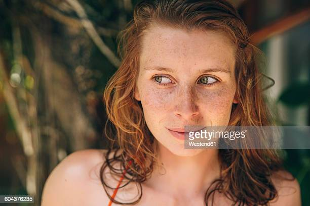 Brazil, Porto Seguro, portrait of curious woman with red hair and freckles
