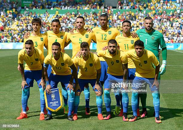 Brazil pose for a team group before the Men's Semifinal Football match between Brazil and Honduras at Maracana Stadium on Day 12 of the Rio 2016...