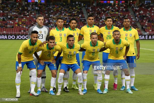Brazil pose for a team photo before the international friendly match between Brazil and Senegal at the Singapore National Stadium on October 10 2019...