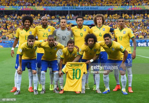80e691bd080 Brazil pose for a team photo holding a Neymar jersey prior to the 2014 FIFA  World