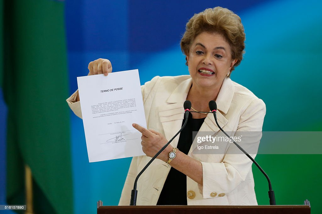 Brazil President Dilma Rousseff holds a paper as she speaks as former president Luiz Inacio Lula da Silva is sworn in as the new chief of staff on March 17, 2016 in Brasilia, Brazil. His controversial cabinet appointment comes in the wake of a massive corruption scandal and economic recession in Brazil.