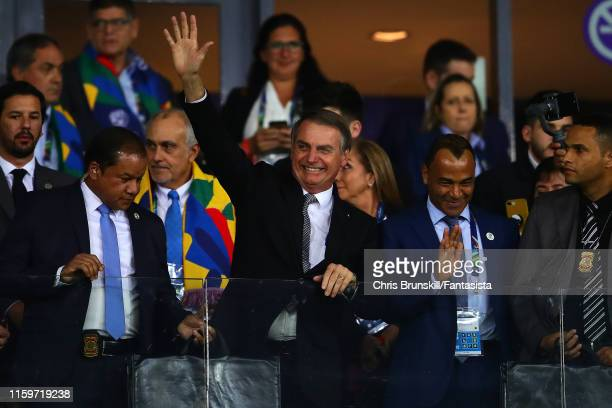 Brazil President Jair Bolsonaro waves to the crowd next to exBrazil captain Cafu during the Copa America Brazil 2019 Semi Final match between Brazil...