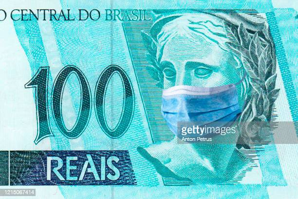 brazil quarantine, 100 reals banknote with medical mask. the concept of epidemic and protection against coronavrius. - dinheiro real imagens e fotografias de stock