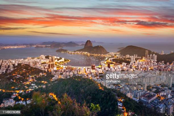 brazil rio de janeiro aerial view with guanabara bay and sugar loaf at night - brazil stock pictures, royalty-free photos & images