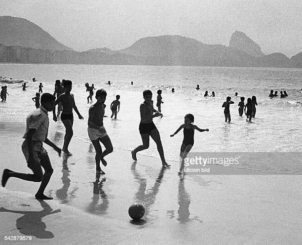 Children playing football on the beach of the Copacabana 1968 Photographer Rudolf Dietrich Vintage property of ullstein bild