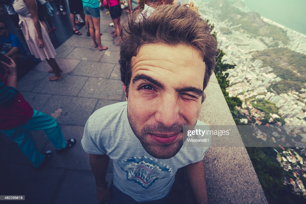 Brazil, Rio de Janeiro, Corcovado, Man twinkling his eye : Photo