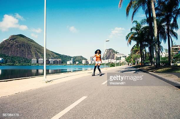 Brazil, Rio de Janeiro, female inline-skater on asphalt street