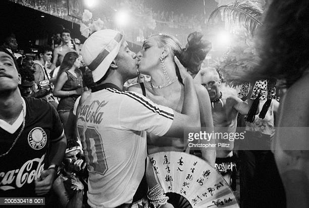 Brazil Rio de Janeiro man kissing transvestite at carnival