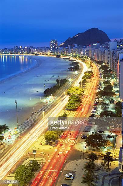 Brazil, Rio De Janeiro, road by Copacabana beach at night, elevated vi