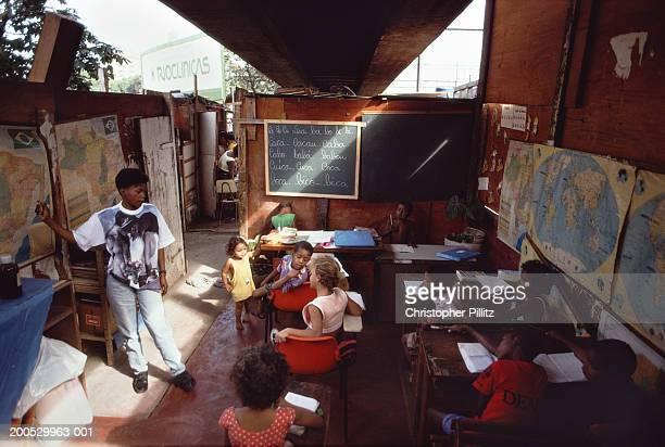 Brazil, Rio de Janeiro, schoolroom under city overpass in shanty town