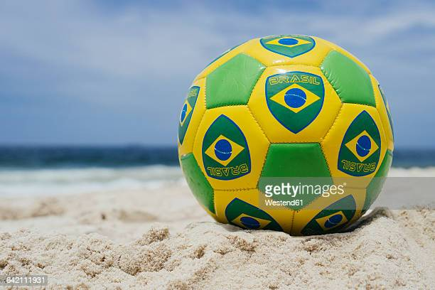 brazil, rio de janeiro, soccer ball laying on the beach - world cup - fotografias e filmes do acervo