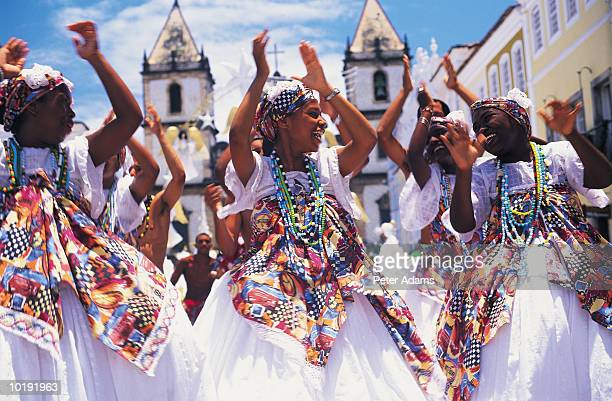 Brazil, Salvador, female dancers in street clapping