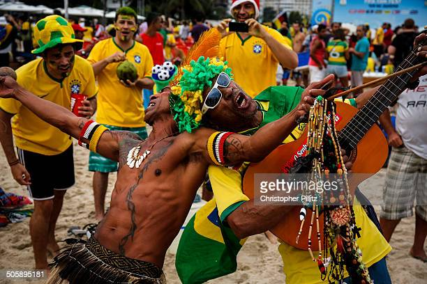 Brazil soccer fans celebrate on Copacabana beach