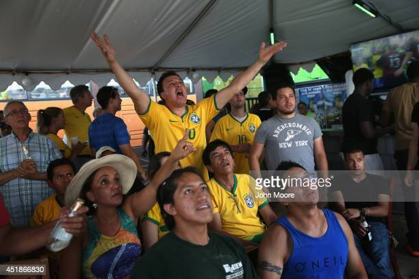 Brazil soccer fans watch as their team falls behind Germany during the semifinal World Cup game on July 8, 2014 in Port Chester, United States. Fans,...
