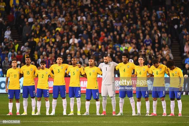 Brazil stand for a minute silence during the Brazil Global Tour match between Brazil and Argentina at Melbourne Cricket Ground on June 9 2017 in...
