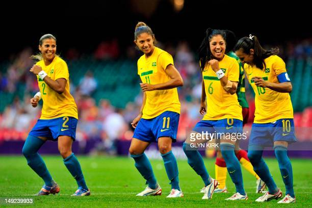 Brazil striker Marta celebrates after scoring the third goal from a penalty during the London 2012 Olympic games women football match between...