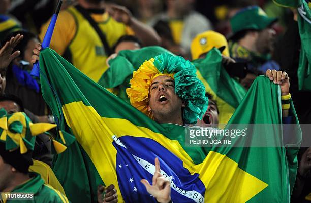 A Brazil supporter celebrates after his team won the 2010 World Cup round of 16 football match Brazil vs Chile on June 28 2010 at Ellis Park stadium...