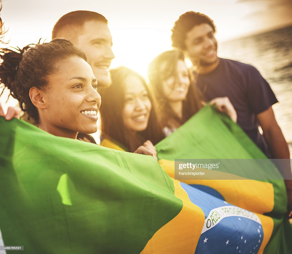 brazil supporter cheering togetherness at the beach soccer match : Stock Photo