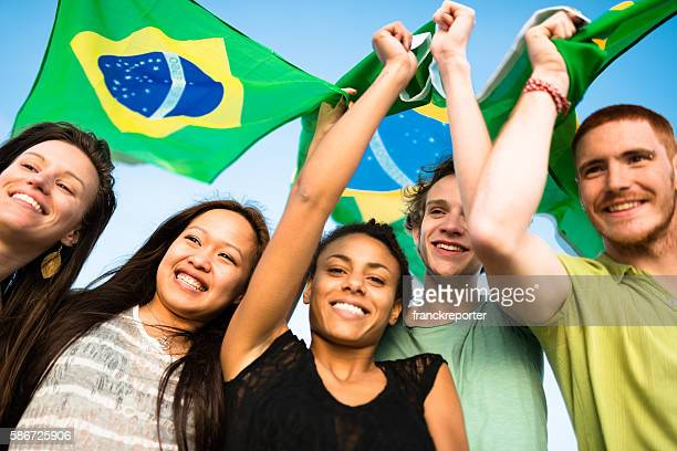 brazil supporter cheering togetherness with brazilian flag