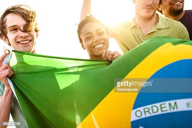 brazil supporter cheering togetherness with brazilian flag - patriotismo - fotografias e filmes do acervo